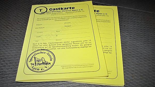 .Zwei gelbe Faltblätter zur Anmeldung für Gastangler.